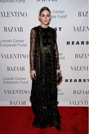 Olivia Palermo looked downright regal at the Evening Honoring Valentino Gala in a black empire gown with geometric gold beading.