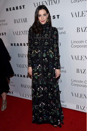 Liv Tyler went for Old World elegance in a floral-embroidered empire gown at the Evening Honoring Valentino Gala.