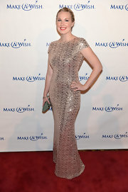 Megan Whittaker sparkled in a champagne-colored fitted dress at the Make-A-Wish Metro Gala.