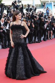 Penelope Cruz wowed in a Chanel Couture floral-patterned ball gown with ruffled panels while walking the 2018 Cannes opening gala red carpet.