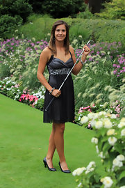 Azahara Munoz wore a gray cocktail dress with a zebra waistband for the Evian Masters Gala.