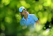 Michelle Wie watches the ball through her sporty shades.