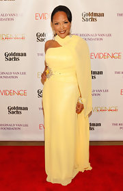 Lynn Whitfield sported a pale yellow, one-shouldered dress with an embellished waist for her red carpet look.