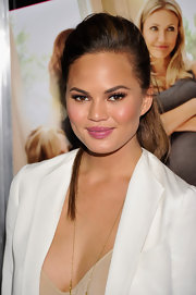 Chrissy Teigen touched up her lips with a pretty mauve gloss at a screening of 'What To Expect When You're Expecting.'