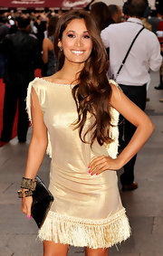Preeya paired her gold metallic dress with gold and black toned bangle bracelets.