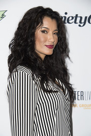 Kelly Hu attended the 'Extraordinary: Stan Lee' event wearing her hair in long, lush curls.