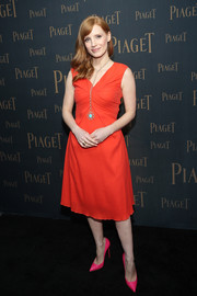 Jessica Chastain was all about simple sophistication in this sleeveless red cocktail dress by Christian Dior during the Extremely Piaget launch.
