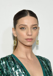 Angela Sarafyan accessorized with a pair of statement gemstone earrings.