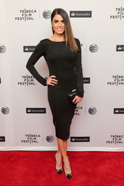 Nikki Reed kept it classic and elegant all the way down to her black lace cap-toe pumps.