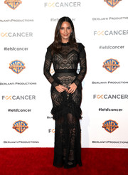 Olivia Munn looked sultry in a sheer black lace gown by Zuhair Murad at the Barbara Berlanti Heroes Gala.