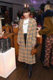 Charli XCX layered a plaid coat over a tee and jeans for the By Far party.