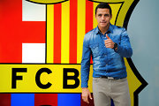 Alexis Sanchez kept it casual in a distressed blue denim button-down.