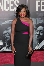 Viola Davis kept it classic in a black and fuchsia one-shoulder dress by Cinq a Sept at the New York screening of 'Fences.'