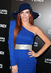 Phoebe paired her cobalt blue one-shoulder dress with a floppy dress hat.