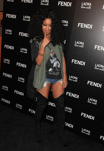 Teyana Taylor paired her cut off shorts with bold over-the-knee boots.