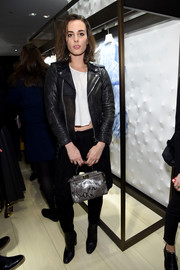 Sophie Auster was edgy in a black leather jacket layered over a white crop-top at the Fendi New York flagship store opening.