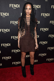Zoe Kravitz made a bold statement at the Fendi New York flagship store opening in a brown mini dress with multiple strappy cutouts.