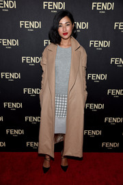 Nicole Warne bundled up in a nude wool coat for the Fendi New York flagship store opening.