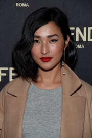Nicole Warne punctuated her beauty look with a vivid red lip.
