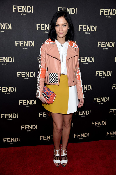 Leigh Lezark added an extra splash of color with a beaded coral Fendi clutch.