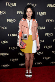 Leigh Lezark attended the Fendi New York flagship store opening looking both edgy and girly in a peach leather jacket with checkered and lettering accents.