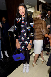For her footwear, Hannah Bronfman selected a pair of pointy white lace-up boots.