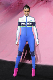 Adriana Lima's hot-pink boots made a stylish contrast to her blue catsuit.