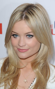 Laura Whitmore kept her beauty look soft and feminine with a matte lip color in a pretty pink hue.