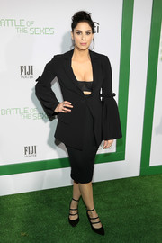 Sarah Silverman flaunted some cleavage in a plunging black skirt suit by Christian Siriano at the LA premiere of 'Battle of the Sexes.'