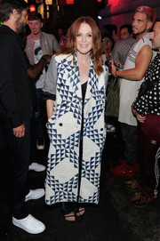 Julianne Moore arrived for the Raf Simons show wearing a mixed-print coat by Calvin Klein.