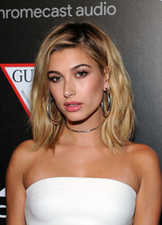 Hailey Baldwin paired her chic hairstyle with huge sterling hoops by Jennifer Fisher.