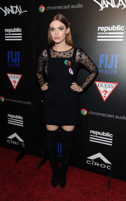 Holland Roden punched up her look with black suede thigh-high boots.