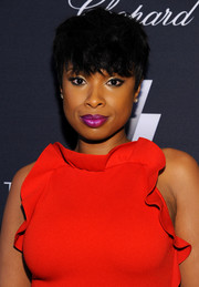 Jennifer Hudson's purple lipstick made a striking contrast to her red frock.