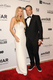 Fergie went for sleek elegance in a minimalist white column dress by Calvin Klein during the amfAR Inspiration Gala.