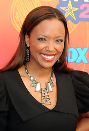 Aisha Tyler paired her black cocktail dress with a silver statement necklace.
