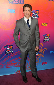 Matthew Morrison paired his navy tie with a grey suit.