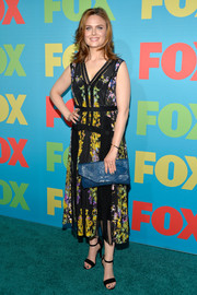 Emily Deschanel paired her dress with a blue crocodile envelope clutch.