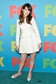Zooey Deschanel sported her trademark retro style at the Fox Programming Presentation with this long-sleeve white peplum mini by Vivienne Westwood Red Label.