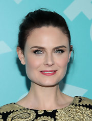 Emily Deschanel's brunette tresses looked classic and chic when pulled back into a bun.