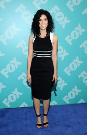 Stephanie Beatriz chose a fitted black sheath dress with white trim at the shoulders and waist for her sleek and sophisticated look at FOX's programming party.