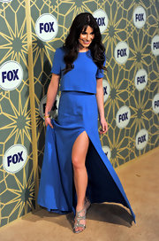 Lea Michele shined in blue at the FOX soiree. She accessorized the understated dress with glittering strappy sandals.