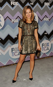 Vanessa glammed things up at the Fox All-Star Party in this gold paillette cocktail dress with sheer mesh insets.