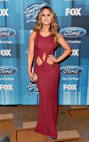 Pia Toscano put her abs on show in a wine-colored cutout gown during the 'American Idol' finale.