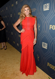 Connie Britton kept it ladylike in a red Talbot Runhof gown, featuring a lace-panel bodice and a tiered skirt, during Fox Broadcasting's Emmy Awards after-party.