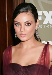 Mila Kunis flashed her bold false lashes while attending an Emmy Party. It was the perfect way to highlight her soft eyeshadow.