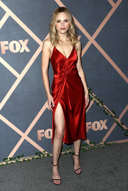 Halston Sage ravished in a slinky red T by Alexander Wang wrap dress at the Fox Fall party.