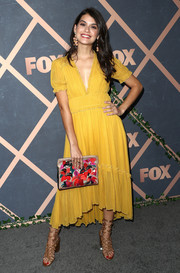 Sofia Black-D'Elia was a drop of summer sunshine in this yellow Ulla Johnson midi dress at the Fox Fall party.