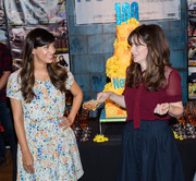 Zooey Deschanel paired a burgundy mesh-panel pussy bow blouse with a blue button-front skirt for the 'New Girl' 100th episode cake-cutting event.