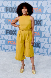 Angela Bassett styled her look with gold platform pumps.