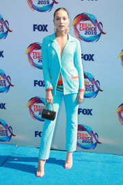 Maddie Ziegler styled her suit with a pair of PVC sandals.
